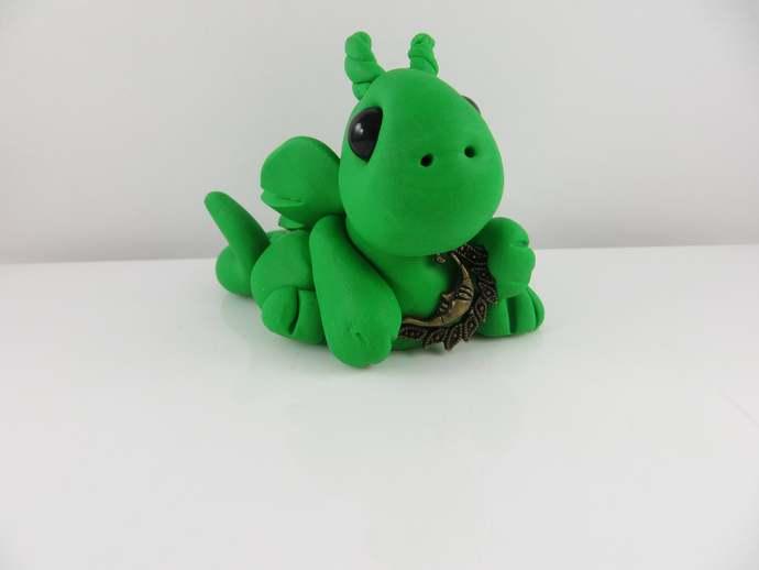 Green clay dragon sculpture figurine