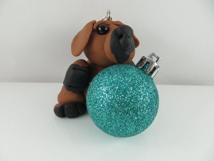 Clay dog Christmas ornament with turquoise glitter