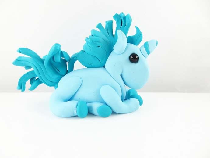 Clay blue unicorn sculpture figurine