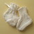 White hand knitted newborn to 3 months baby booties trimmed with matching