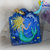 Enchanting handpainted mermaid and dolphin with fish on blue wood pendant