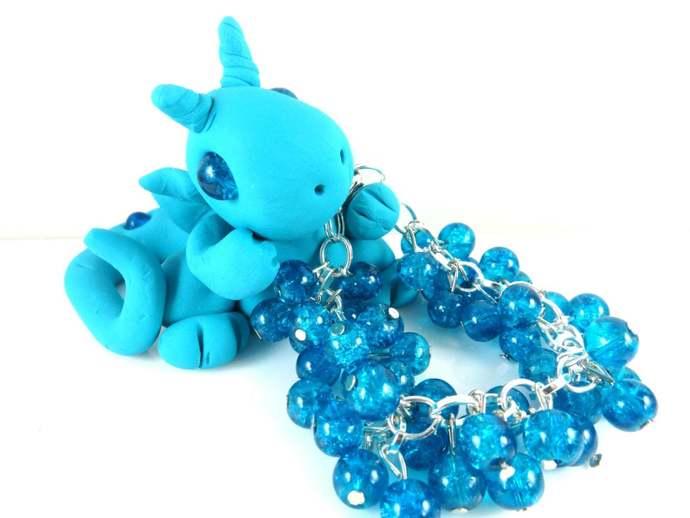Clay blue dragon with girls blue cha cha bracelet