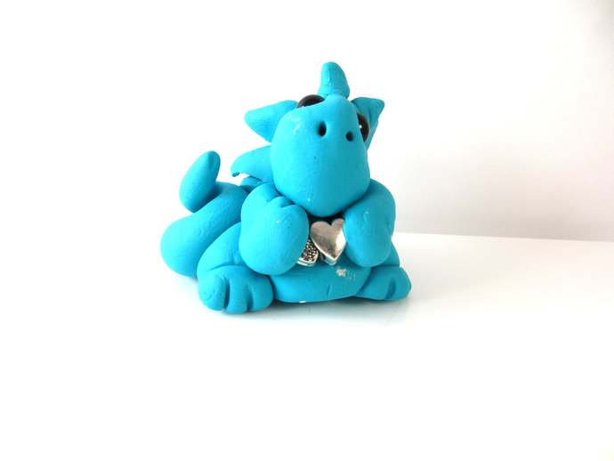 Clay baby dragon sculptue figurine with double hearts