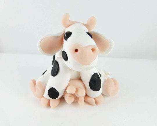 Clay cow sculpture figurine