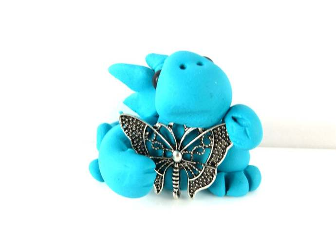Turquoise clay baby dragon sculpture figurine with a butterfly