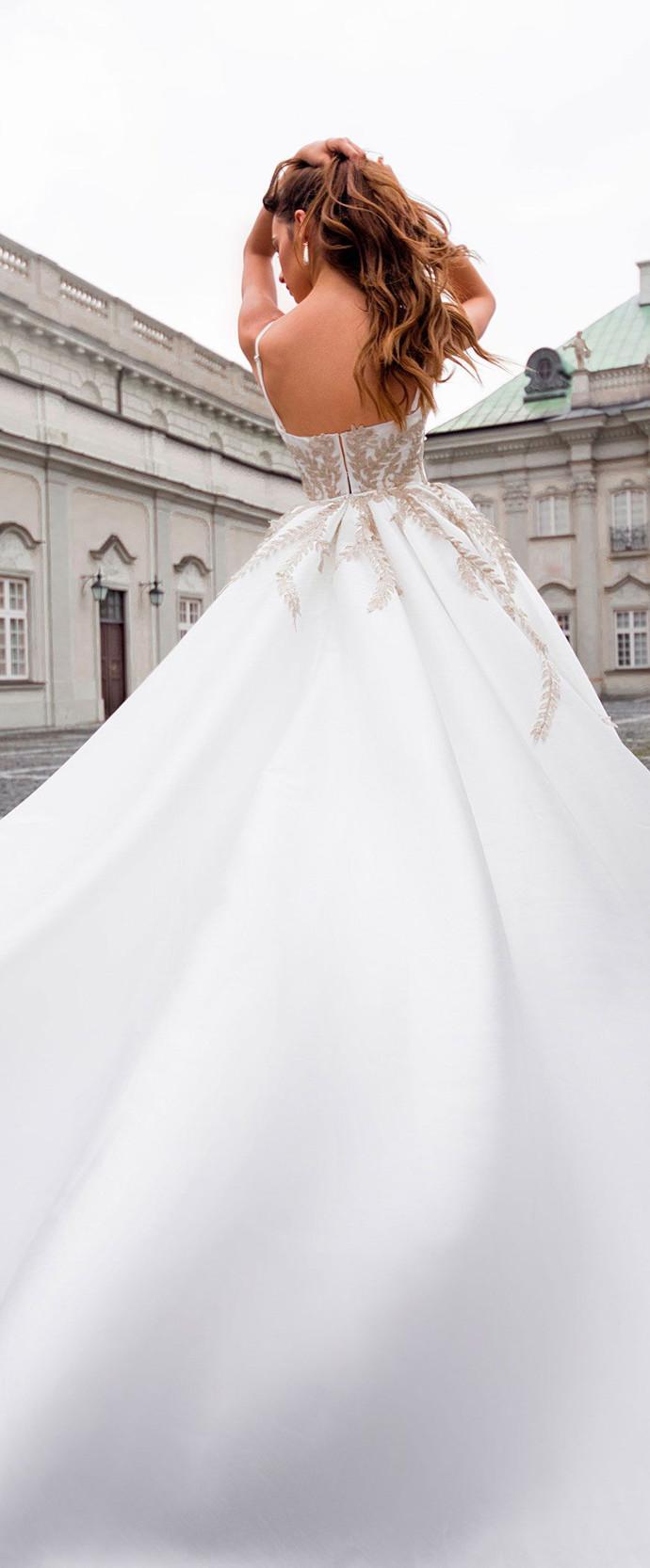 Spaghetti Strap Ball Gown Wedding Dress Featuring Leaf Appliqués and Long Train