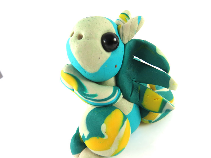 Clay multi color baby dragon with yellow stripe feet