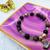 Gemstone stretch bracelet with moon shell charm