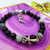 Gemstone stretch bracelet with spike charm and cross detail