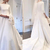 2020 A Line Elegant Wedding Dresses Bateau Neck Long Sleeves Sweep Train Covered