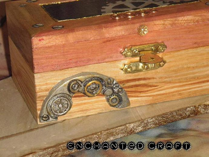 a handpainted Steampunk wood box with polymer clay details