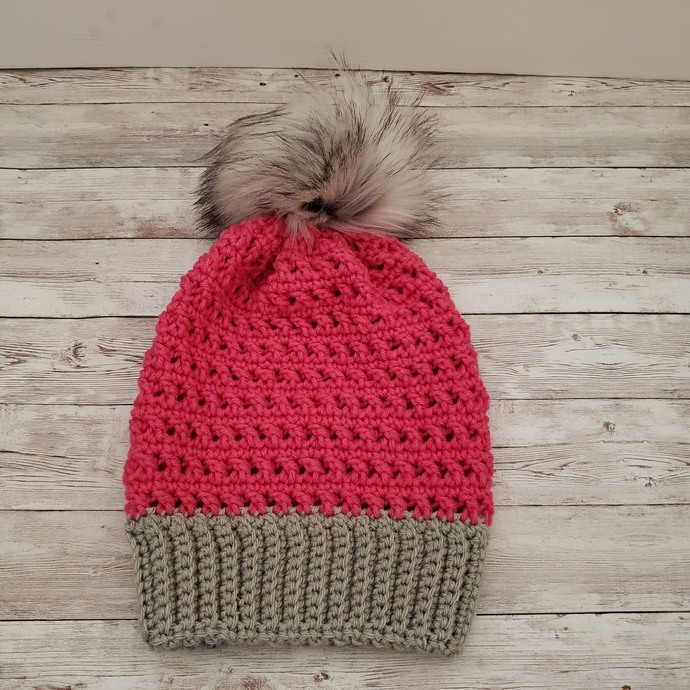 Pink and grey beanie with faux fur pompom