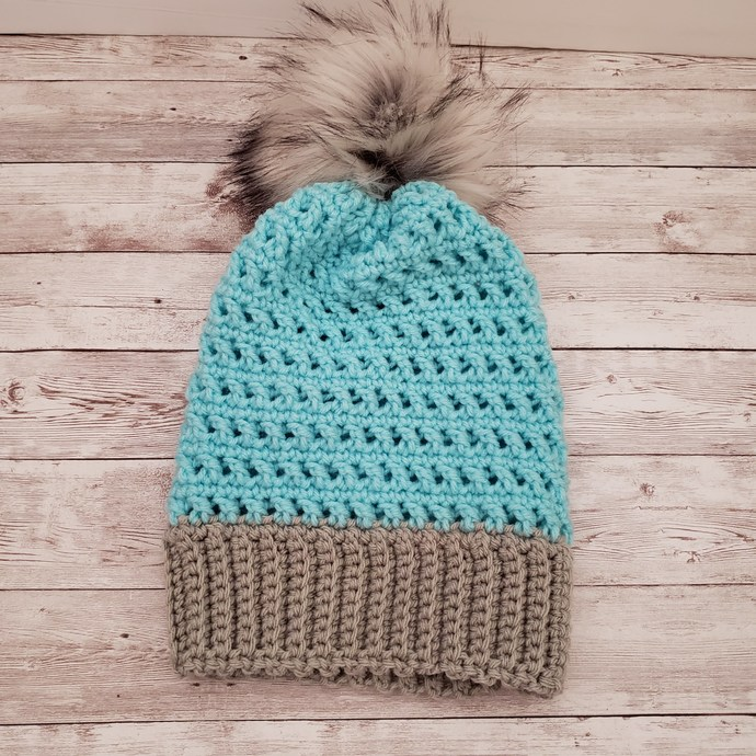 Light blue and grey beanie with faux fur pompom