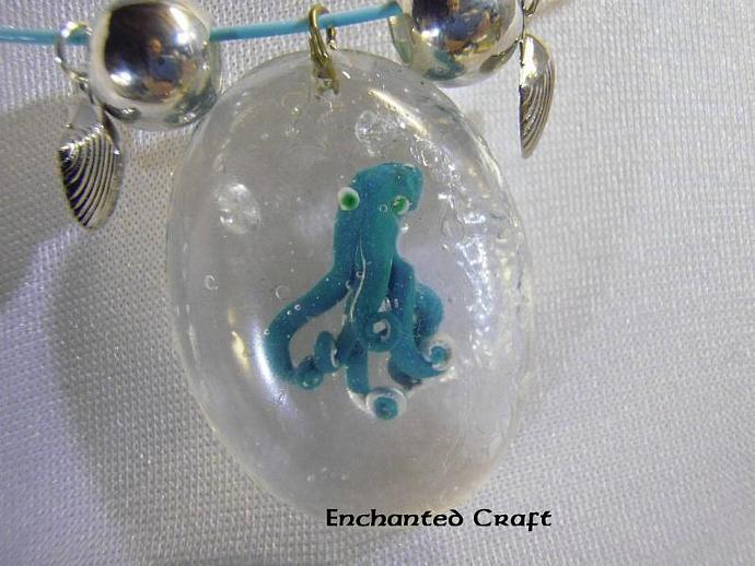 Captured aqua green octopus necklace