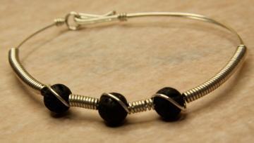 Bracelet- Lava Stone Swirl- Sterling silver and black lava stones