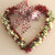 Heart Wreath with Yellow Roses and Baby's Breath on Red Mylar wall hanging Love