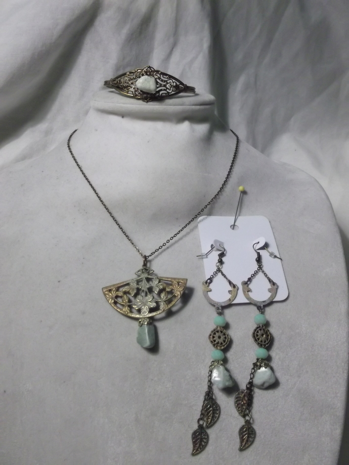 Three piece green stone and metal jewelry set