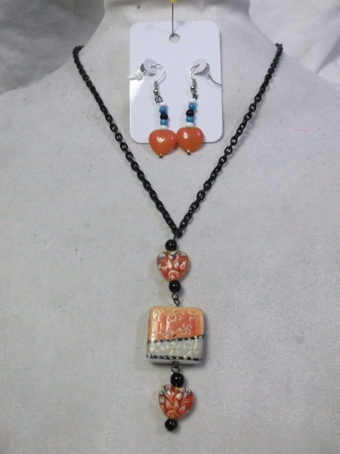 Two piece orange and off white jewelry set with heart beads