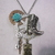 Western Steampunk necklace with boot charm on gear with key, acrylic rose and