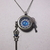 Watch casing necklace with dragon's eye, watch hand, gear, and key