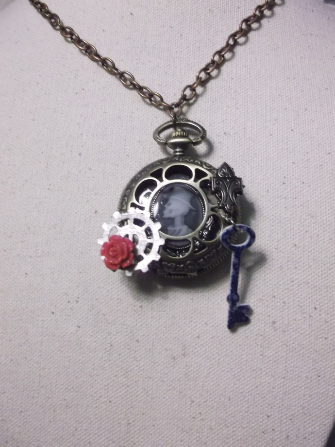 Skull cameo inside watch casing necklace