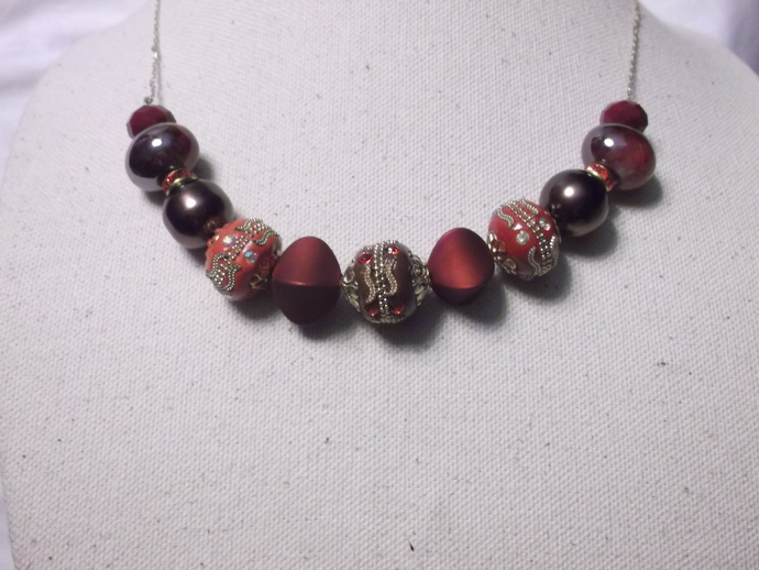 Red and gold decorated beads on lightweight gold base metal chain