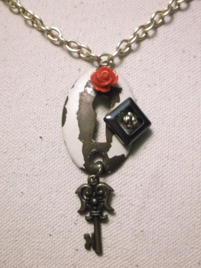 Found object keyhole necklace with small key, red acrylic rose bead, gold bead