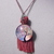 Bright pink tassel necklace with acrylic pendant with abstract tree design