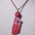 Bright pink tassel necklace with pale pink metal flower charm