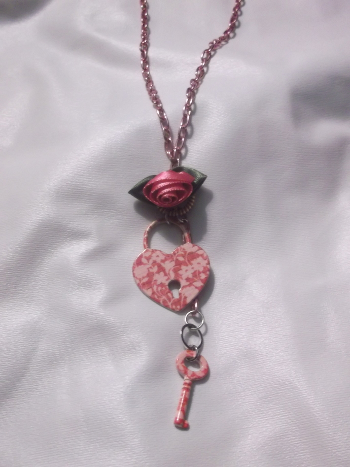 Pink floral patterned heart and key charm on pink chain with silk rose accent