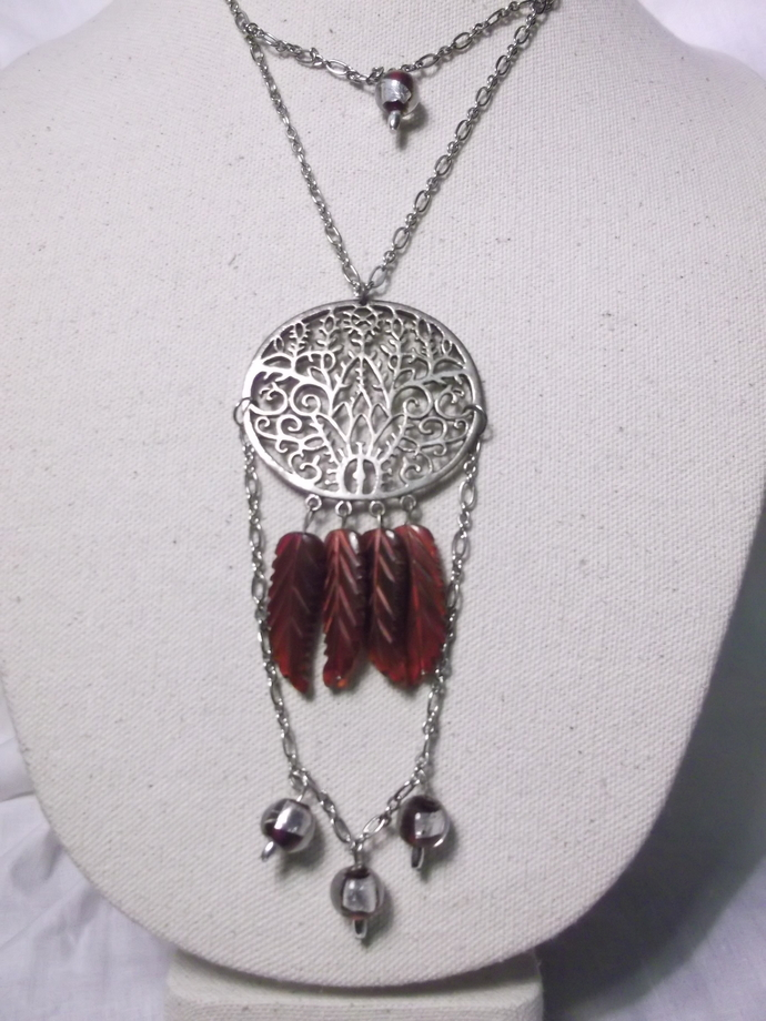 Filigree style pendant necklace with deep red feather shaped stone beads and red