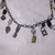 Brass color base metal chain with silver color and copper color charms accented