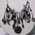 Dangling charms and beads necklace in black, silver, and grey tones