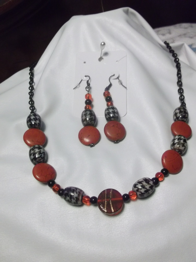 Herringbone patterned beads with red reconstituted stone beads and lampwork bead
