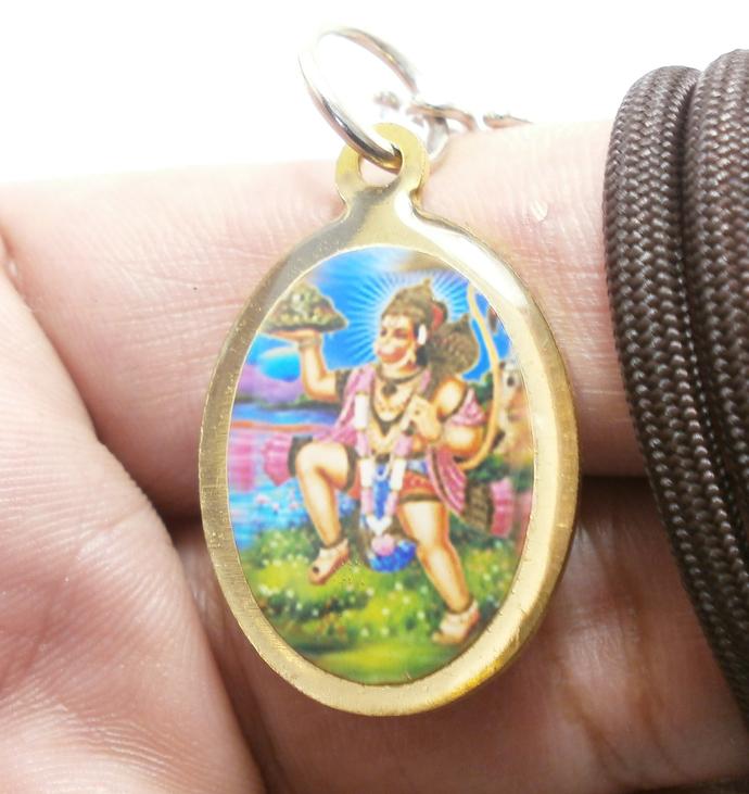 Lord Hanuman moving Dronagiri mountain with magic herb to cure Lakshmana