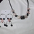 Pink and black modernistic necklace and earring set with iridescent accent beads
