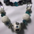 White and turquoise clay beads decorated with small metal beads and turquoise