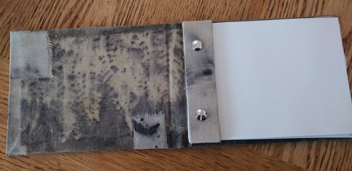 Handcrafted Notepad from eco-printed cloth with a cute kitten playing in the