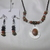 Brown stone bead on mother of pearl teardrop shaped pendant with various color