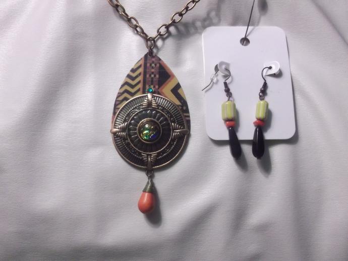 Metal medallion pendant with orange bead dangle on large metal pendant with