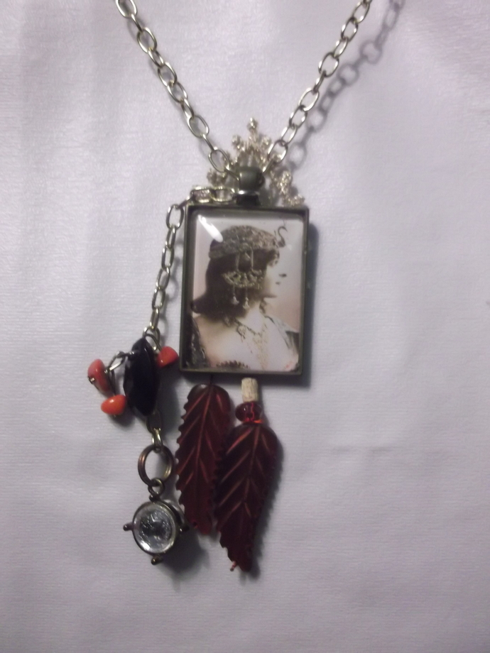 Portrait pendant necklace of woman in fancy costume ball headdress with stone