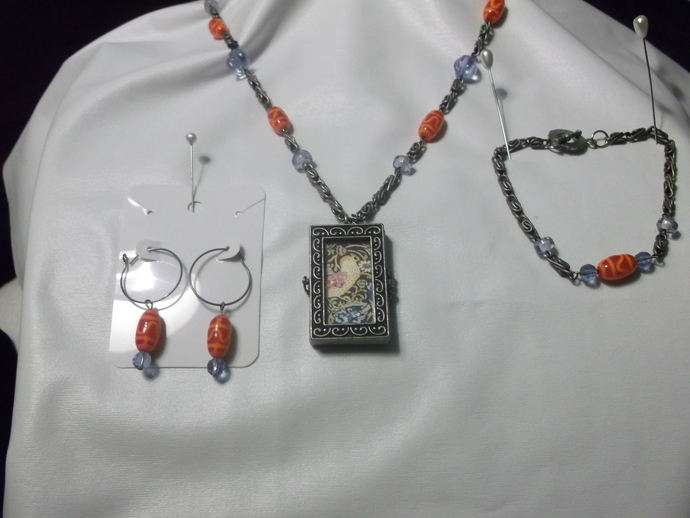 Three piece Art Nouveau inspired jewelry set in blue, red, and yellow with two