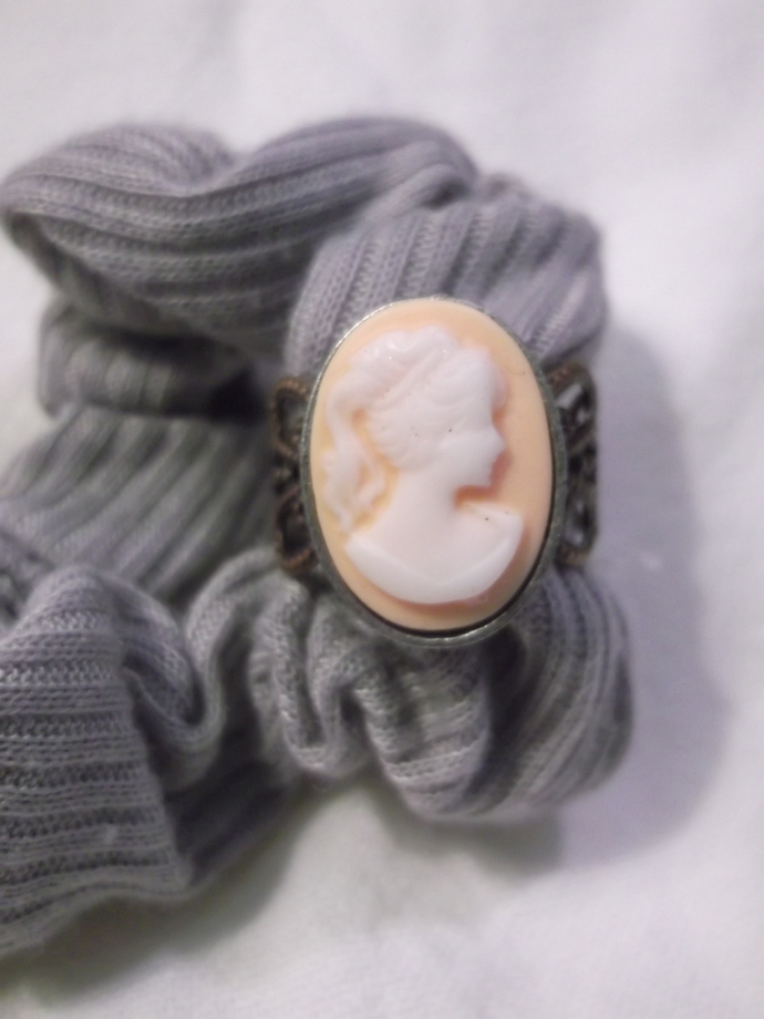 Acrylic cameo with peach color background on base metal filigree ring