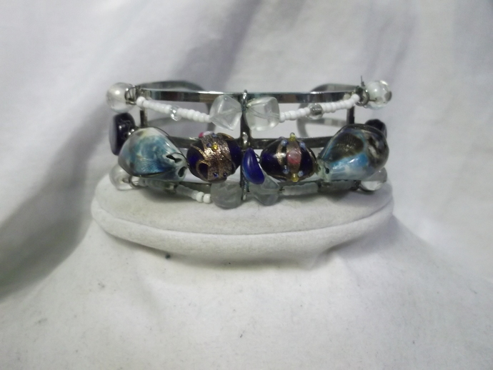 Metal cuff bracelet with lampwork beads and turquoise color shells