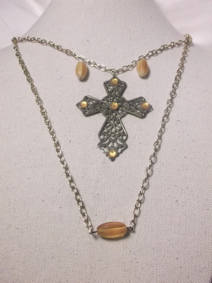 Bronzish color filigree cross with gold color rhinestones on double strand