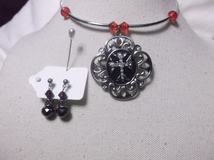 Silver and black color cross pendant on memory wire with silver and red beads