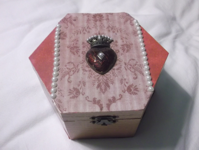 Rose gold and pinkish hexagon shaped storage box with heart and crown pendant on