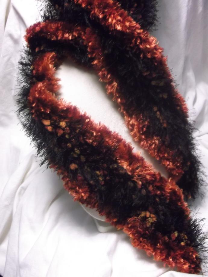 Eyelash and furry yarn scarf in rust and black