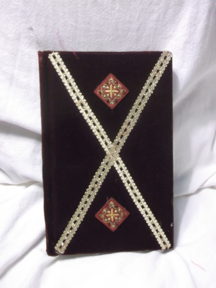 Maroon covered journal with gold trim and diamond shaped applique