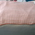Knitted baby blanket peach and white striped ribbed pattern